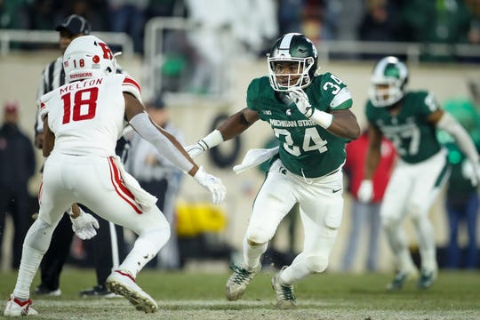 Michigan State's Antjuan Simmons runs down Rutger's Bo Melton during a game at Spartan Stadium on November, 24, 2018.
