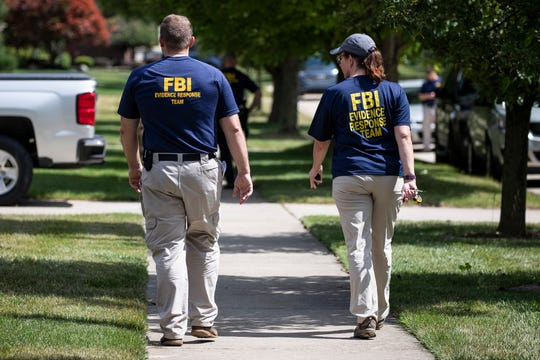 FBI agents leave UAW president Gary Jones' home in Canton after evidence is collected, Wednesday, August 28, 2019.
