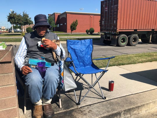 Francis Sawicki, 67, sits in the parking lot of the Royal Oak Walgreens where his belongings were stolen two weeks earlier. Sawicki, photographed Aug. 28, 2019, sells pens and pencils outside Walgreens to supplement his income.