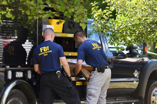 FBI agents load material collected from the home of UAW President Gary Jones during a search of his Canton home.