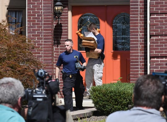 FBI investigators leave the home of UAW President Gary Jones after a search on Wednesday, August 28, 2019 in Canton Township.