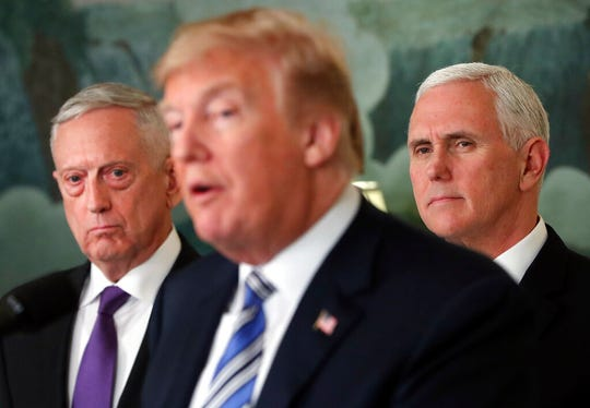 "In this March 23, 2018 file photo, Defense Secretary Jim Mattis, left, and Vice President Mike Pence, right, listen to President Donald Trump speaks in the Diplomatic Room of the White House in Washington.  Mattis warns bitter political divisions have pushed American society to the ""breaking point"" in his most extensive public remarks since he resigned in protest from the Trump administration."