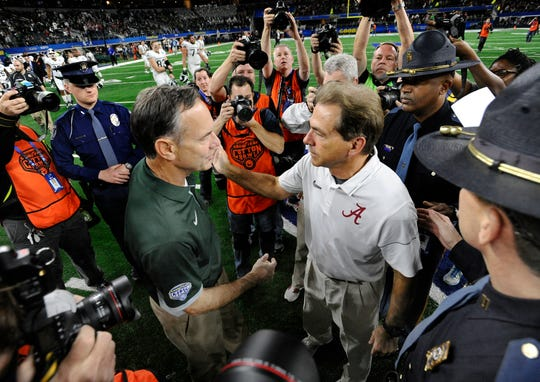 MSU coach Mark Dantonio and Alabama coach Nick Saban meet at the center of the field after the Tide beat the Spartans in the 2015 College Football Playoff.