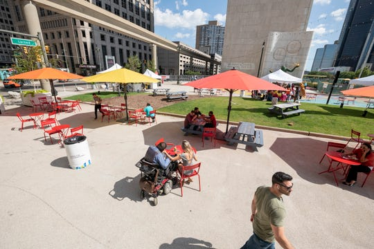 Food trucks and pedestrians occupy the Spirit Plaza in downtown Detroit Wednesday.