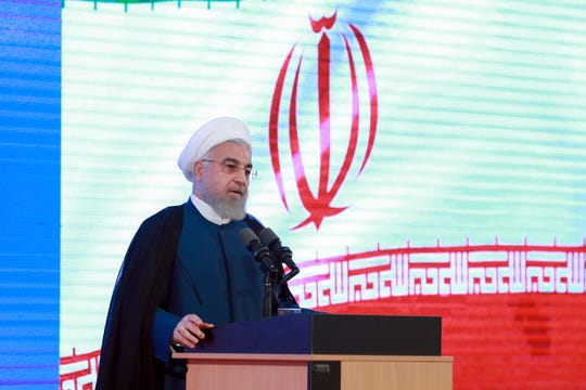 In this photo released by the official website of the office of the Iranian Presidency, President Hassan Rouhani speaks in a ceremony in Tehran, Iran, Tuesday, Aug. 27, 2019. Rouhani back-pedaled Tuesday on possible talks with Donald Trump, saying the U.S. president must first lift sanctions imposed on Tehran, otherwise a meeting between the two would be a mere photo op.