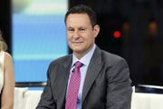 "This Jan. 17, 2018 file photo shows co-host Brian Kilmeade on the set of ""Fox & Friends"" in New York.  Fox's political-ad spending reports filed at the FCC show robust spending on programs that figure in Trump's viewing, like ""Fox & Friends."""