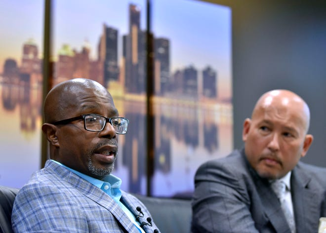 Darrell Siggers, 55, left, talks about the horrible things he witnessed while in prison for 34 years as his attorney, Wolf Mueller, listens. Siggers was wrongfully convicted for a murder he did not commit.