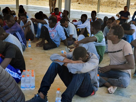 Rescued migrants rest near the city of Khoms, around 120 kilometers (75 miles) east of Tripoli, Libya., Tuesday, Aug. 27, 2019. At least 65 migrants, mostly from Sudan, were rescued, said a spokesman for Libya's coast guard, with a search halted for those still missing. The coast guard gave an estimate for those missing and feared drowned of 15 to 20 people.