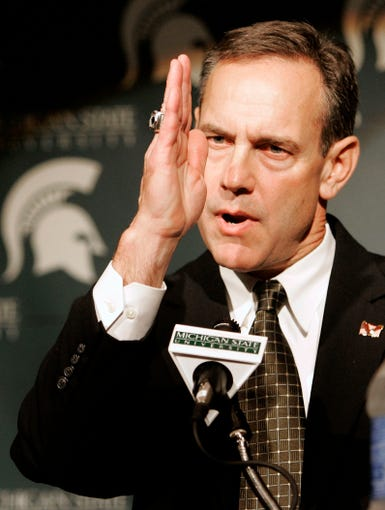 "MSU names Mark Dantonio the new head football coach during a Monday noon news conference in East Lansing, 27 Nov 2006. Dantonio made the gesture while speaking about Michigan being a divided state that became ""a little more green today."""