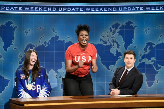 "Leslie Jones, center, flanked by Ice Hockey Olympian Hilary Knight, left, and Colin Jost during the ""Weekend Update"" segment on ""Saturday Night Live,"" in New York on March 3, 2018."