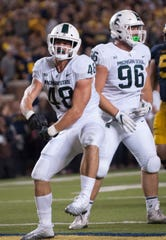 Michigan State defensive ends Kenny Willekes (48) and Jacub Panasiuk (96) return to a loaded defense.
