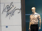 The Lord & Taylor logo is seen next to a mannequin in a window display at their flagship store on Fifth Avenue in New York.