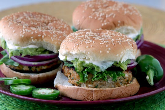 Cheddar jalapeño chicken burgers with guacamole,