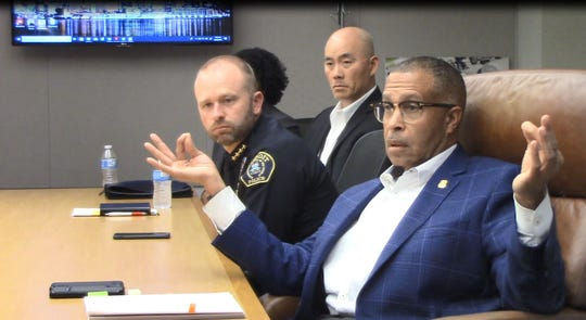 From left, police attorney Grant Ha and assistant police chief David LeValley listen as Chief James Craig addresses citizens and police board members Wednesday, Aug. 28, 2019.