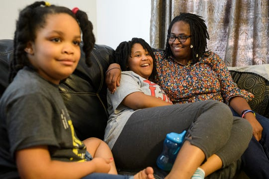 Deleah Payne, 12, center, spends time with her mother  Delisa, right, and 6-year-old sister Delynn, left, as they watch movie clips playing on their living room television in Evansville, Tuesday evening, Aug. 27, 2019. Deleah and Delynn were both diagnosed with autism.