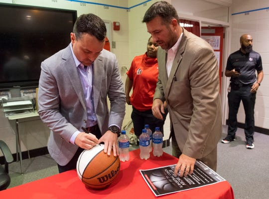 Indiana University Men's Basketball coach Archie Miller signs a basketball for Pat Shoulders before the Shoulders Family Lecture Series at Harrison High School in Evansville, Ind., Tuesday evening, Aug. 27, 2019.