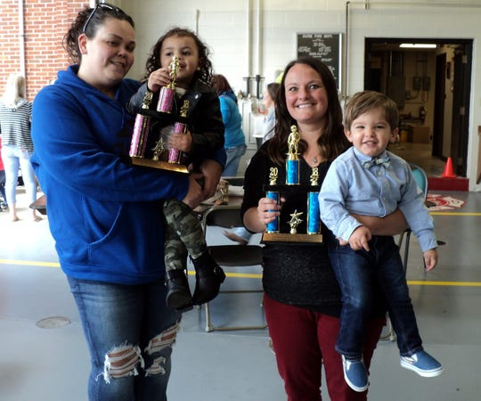 Winners from the 2018 Clyde Beautiful Baby Contest received trophies for Best in the show.