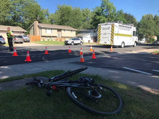 A bicycle involved in a collision with a Poudre School District bus Wednesday morning lies on the lawn at Beattie Elementary School in Fort Collins