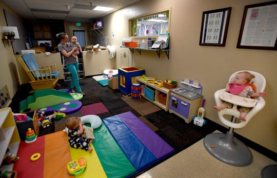 Staff look after several infants at Teaching Tree Early Childhood Learning Center in Fort Collins, Colo. on Tuesday, Aug. 27, 2019.