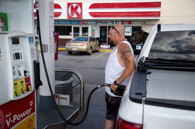Shawn O'Brien of Cape Coral pumps gas at the Circle K gas station at the corner of Pine Island Road and Del Prado Boulevard on Wednesday, August 28, 2019.