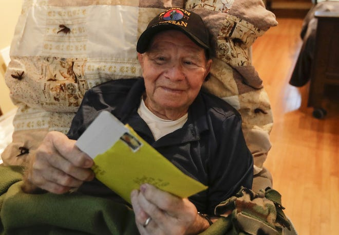 Ed Engle, a Korean War veteran, opens up a birthday card he received for his 91st birthday Monday, August 26, 2019, at his home in Kewaunee. His family asked people to send Engle a card for his birthday on Aug. 23 because he loves reading the cards. Engle recently went into hospice because of Alzheimers.