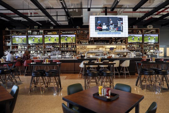 The Turn, which opens Aug. 29, 2019 in the Green Bay Packers' Titletown District, includes seven sports simulation bays, a restaurant and sports bar.