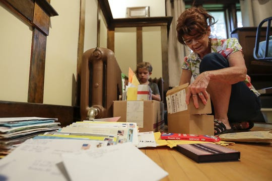 Tina Graham goes through boxes of letters that have poured in for her father Ed Engle's 91st birthday at their home in Kewaunee. Graham says they've received cards from all over the world including Sweden and Scotland. Engle, who recently went into hospice because of Alzheimer's, has received more than 2,600 cards after his family put out the call requesting them for what likely is his last birthday.