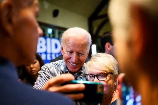 Democratic presidential candidate and former Vice President Joe Biden takes selfies with supporters after a town hall at the Cleveland Park Event Center in Spartanburg Wednesday, Aug. 28, 2019.