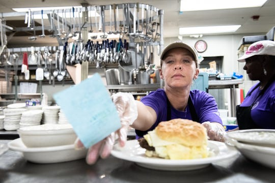 Brooke Long, a member of the kitchen staff at Tommy's Country Ham House in Greenville, plates an order during her shift Wednesday, August 28, 2019. Long, who has worked at the restaurant for about a year, has been in recovery from an addiction to heroin for 15 months after overdosing four times before deciding to get clean.