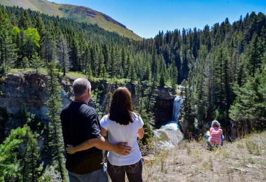 Frank and Gina Fleming of Butte enjoy the Falls Creek waterfall Tuesday. Dan Barrett sold 442 acres to the Rocky Mountain Elk Foundation, which turned it over to the U.S. Forest Service. Now the 442 acres, in addition to 26,000 acres of adjoining national forest, is publicly accessible.