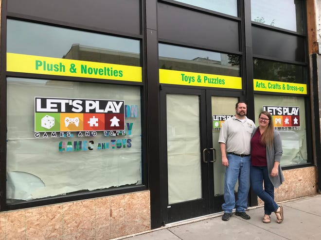 Lee and Nicole Wiegand in front of their upcoming toy store expansion