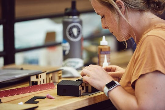 Morgan Bloom, an architecture graduate student at Montana State University, works on scale models of various housing designs in Bozeman, as part of the Augusta Rural Teacher Housing project led by Rebecca Wolfe with the MSU School of Architecture.