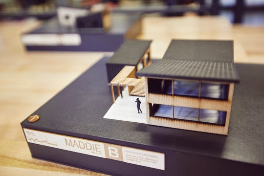 Montana State University architecture students work on scale models of various housing designs.