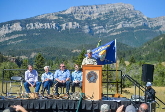 "Bill Avey, supervisor of Helena-Lewis and Clark National Forest, speaks during a ceremony Tuesday celebrating new public access into the Rocky Mountain Front at Falls Creek. To the left are U.S. Sen. Steve Daines, Lt. Gov. Mike Cooney, Erik Nylund of U.S. Sen. Jon Tester's office and Brett Simons, a staffer for Congressman Greg Gianforte. ""They kept the property pristine,"" Avey said of the Barrett family and the Falls Creek land."