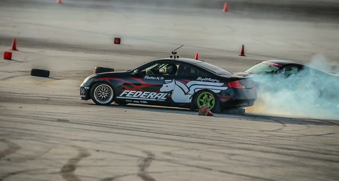 Alex Grenier, in front, and Von Burrell go at it during Round 3 of the Proline Drifting Championships Aug. 25 at the Guam International Raceway.
