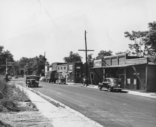 The Smith Mills Deposit Bank was the second one robbed in Henderson County and it operated from 1901 to 1935, when it was consolidated into Ohio Valley National Bank & Trust. The bank building is depicted at center in this photo of downtown Smith Mills taken in the late 1940s.
