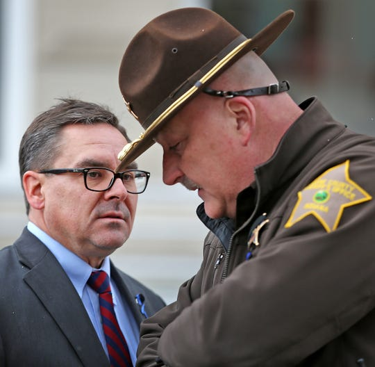 Boone County Prosecutor Todd Meyer, left, and Boone County Sheriff Mike Nielsen talk outside the Boone County Courthouse, Wednesday, March 7, 2018, after Anthony Baumgardt's initial hearing in the killing of Boone County Sheriff's Deputy Jacob Pickett.