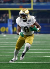 """I've been trying to deliver a lot more blows this year,"" says Notre Dame wide receiver Jafar Armstrong (8).  ""As I'm delivering the blows I feel myself not feeling as much pain as I felt last year."""