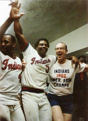 Razor Shines (center) celebrates with Max Schumacher after winning the 1986 American Association title.