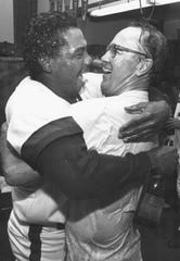 Razor Shines hugs Max Shumacher during clubhouse celebration in 1988.