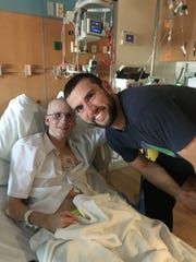 Andrew Luck posed for a photograph with Colton Crace in 2016 at Riley Hospital for Children. This was Colton's second battle with cancer; his first came was when he was a baby.