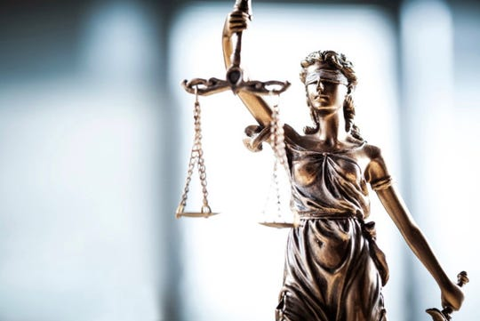 Figurine of the scales of justice.