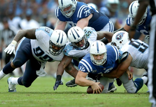 Indianapolis Colts quarterback Andrew Luck (12) falls on his own fumble after he was sacked by the Tennessee Titans defense in the third quarter of their game Sunday, September 27, 2015 at Nissan Stadium in Nashville TN.