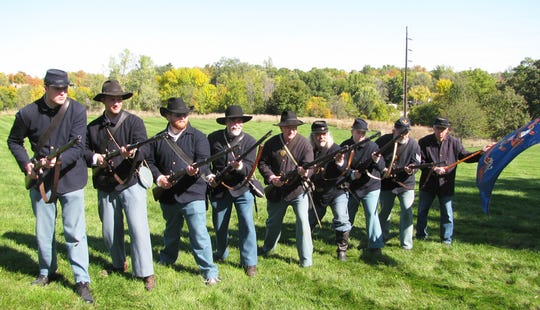These Civil War reenactors in Union garb are part of the Army of the Southwest reenactment group, of which presenter O.J. Fargo of Creston (second from right) is president.