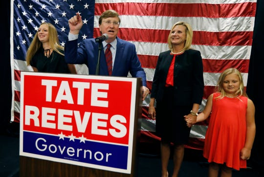 Lt. Gov. Tate Reeves, center, flanked by daughter Tyler Reeves, left, wife Elee Reeves, second from right, and his youngest daughter, Maddie Reeves, speaks to supporters at his victory party after being declared winner of the runoff for the Republican nomination for governor in Jackson, Miss., Tuesday, Aug. 27, 2019. Reeves beat former Mississippi Supreme Court Chief Justice Bill Waller Jr. in the runoff.