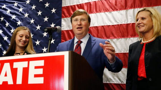 Lt. Gov. Tate Reeves, center, flanked by daughter Tyler Reeves, left, and wife, Elee Reeves, celebrates after being declared winner of the runoff for the Republican nomination for governor in Jackson, Miss., Tuesday evening, Aug. 27, 2019.