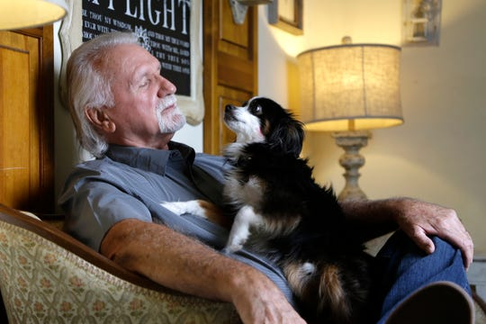 In this Aug. 7, 2019, photo, Ron Bledsoe sits in his home in Powell, Tenn. Bledsoe drove a dump truck and a water truck at the Kingston Fossil Plant coal ash spill site. He now suffers from Chronic Obstructive Pulmonary Disease.