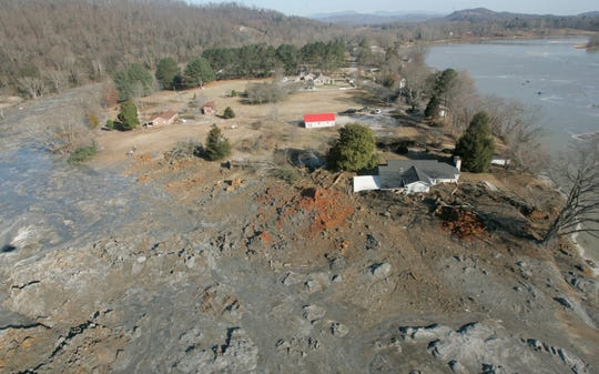 In this Dec. 22, 2008 file photo, an aerial view shows homes that were destroyed when a retention pond wall collapsed at the Tennessee Valley Authorities Kingston Fossil Plant in Harriman, Tenn. A backlash is growing from the Tennessee Valley Authority's handling of the nation's largest coal ash spill a decade ago. Workers said they were prohibited from wearing dust masks while cleaning up the ash and now suffer from cancers and lung diseases. The TVA contractor Jacobs Engineering denied their claims, saying the cleanup posed no health hazard.