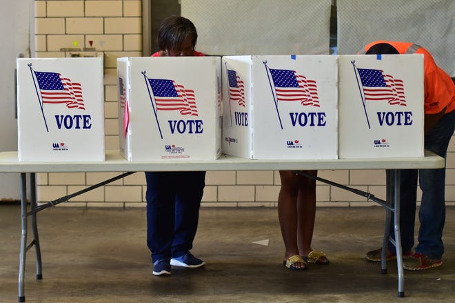 Voters cast their ballots in a runoff election last August. In Tuesday's primary, a number of Mississippians are hoping to unseat Mississippi's incumbent U.S. House representatives.