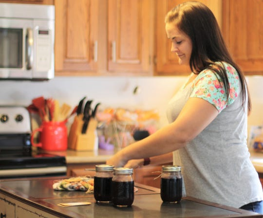 "Every three days, Megan Million makes seven 12-ounce jars of elderberry syrup. ""I buy the elderberries dry from a farm in California and organic cinnamon, ginger and cloves,"" she said. ""I buy two gallons at a time of local raw honey from Townsend."" Halls, Aug. 28, 2019"